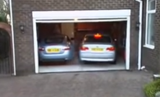 garage inside with car. Man Drives His Car Inside The Garage, But When He Steps Out? Things Get Interesting Garage With E