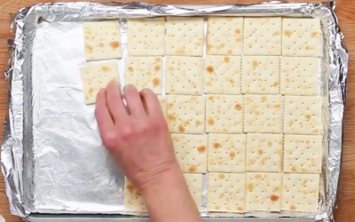 She Lines Saltines Along A Tray. But When She Pours The Secret Ingredient On? I Can't Stop Drooling