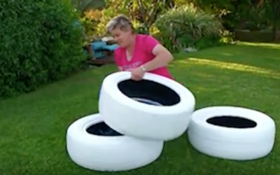 She Paints 3 Used Tires White Then Places Them On Top Of Each Other. The End Result? Awesome
