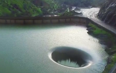 Man Notices A Strange Hole In This Lake, So He Gets a Drone, Flies It Inside, and Captures This