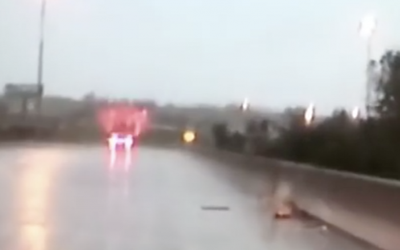 Cops Drive Over a Bridge During a Torrential Downpour. Then They Notice THIS On The Road!