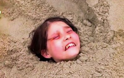 10-Year-Old Kid Spots a Young Girl Buried In The Sand Alive At The Beach. Then THIS Happens To The Girl!
